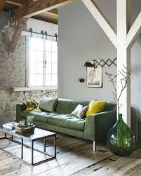 rustic living room with exposed beams exposed brick and a green