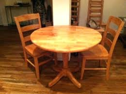 small round wood kitchen table small wooden kitchen table nourishd co