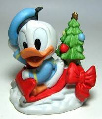 baby donald duck on sled bisque ornament from our