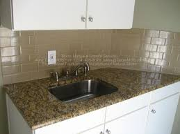 example of new venetian gold granite in white kitchen with subway