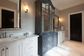 dark gray distressed bathroom linen cabinet with antiqued mirrored