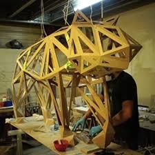 geometric wood sculpture animal instinct the of geometric wooden animal sculptures