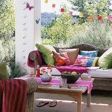 use bright textiles and shabby chic furniture will make the porch