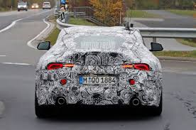 cambered supra spied toyota supra sheds more camouflage reveals taillights