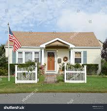 american flag pole beautiful suburban bungalow stock photo