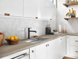 black kitchen faucets kitchen with white cabinets and black faucet using an