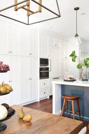 white shaker kitchen cabinets to ceiling wall of floor to ceiling shaker cabinets transitional