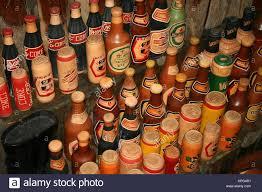 mozambique flea market ornamental soda cans and bottles