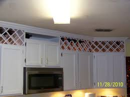 Above Cabinet Lighting by Use The Space Above The Kitchen Cabinets To Create A Wine Rack