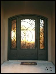 brown wooden double front doors with glass in a unique design of