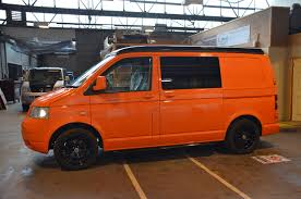 orange volkswagen van lambo orange t5 camper welsh coast campers