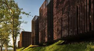 chambre des metiers mont de marsan mont de marsan s timber slatted volumes float out from a grassy