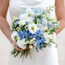wedding flowers blue and white country style bouquet consiting of blue delphinium and hydrangea and
