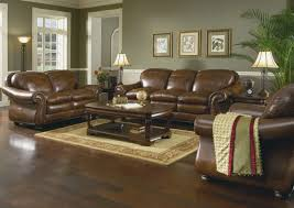 sofa on the brown wooden flooring combined with rectangle brown
