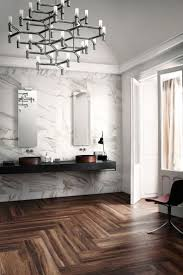 calacatta marble walls wide plank herringbone wood floors and