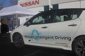 white nissan car riding in nissan u0027s self driving car is still a white knuckle