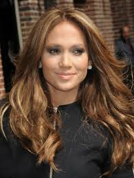jlo hair color dark hair jennifer lopez has a warm golden brown hair color that s a