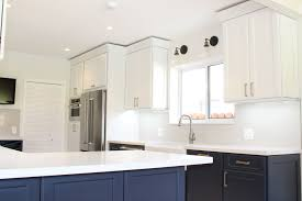 kraftmaid dove white kitchen cabinets my beautiful new kitchen with contrasting midnight blue and