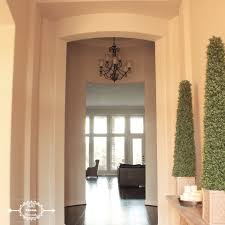 architectural homes entry foyer rotunda wood floors grey gray walls architectural home