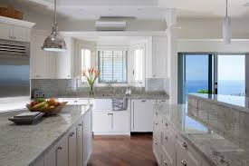 white cabinets with white granite a pristine paradise tropical kitchen hawaii by barker