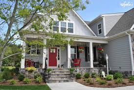 house with a porch s farmhouse style front porch with pops of