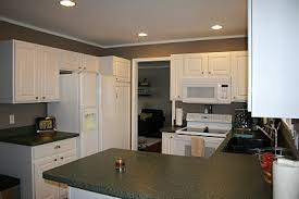 white cabinets with green countertops u2014 thenest