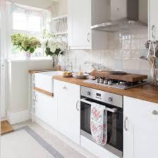 white kitchen white backsplash kitchen contemporary kitchen white oak countertops and