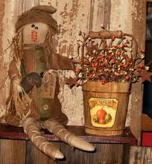 scarecrow holding doll fall decorations primitives
