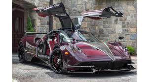 pagani red carbon fiber and 24 karat gold make pagani huayra shine