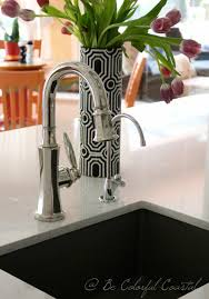 polished nickel bar sink polished nickel newport brass metropole faucet in a coastal kitchen