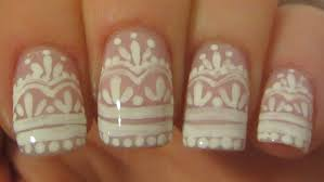elegant bridal lace design in subtle pink and white nail art