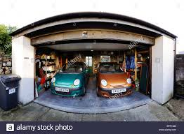 two small daewoo matiz cars parked domestic double garage stock stock photo two small daewoo matiz cars parked domestic double garage
