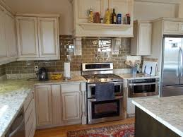 limestone backsplash kitchen by brown wooden islands white cabinets black countertops what