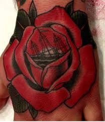 tattoo you sinking ship in a rose on my hand tradional tattoos