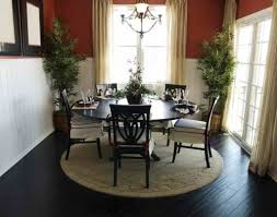 small dining room using wall mirrors and square dining table