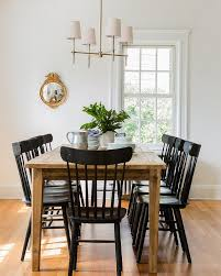 chic cottage dining room features a farmhouse dining table lined