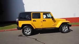yellow jeep wrangler unlimited 2015 jeep wrangler unlimited sahara baja yellow fl651932