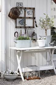 82 best decorating for spring images on pinterest artificial inspiration vintage table repurposed vignettes tin flower containers repurposed old window frame love this gardening station idea