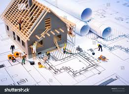 project house building house on blueprints worker construction stock photo