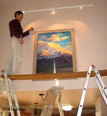 how to hang a painting hang large paintings with ladders and scaffold