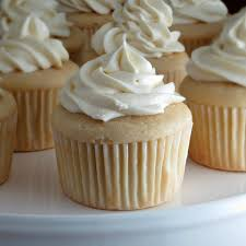 white cupcakes with truffle filling and white chocolate cream