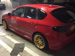 paint corrected red 2008 subaru wrx by wicked auto detailing in
