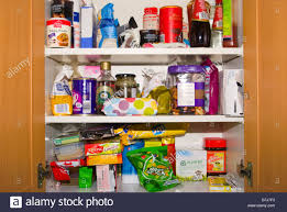 open kitchen cupboard cupboards containing food foodstuffs stock
