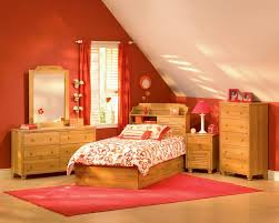 delightful attic bedroom design with wooden inclining roof and