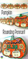 rounding decimals pennant with a pumpkin theme fun math