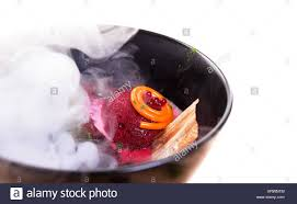 molecular cuisine molecular cuisine delicious soup with beetroot stock photo royalty