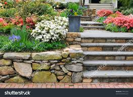 Garden Rock Wall by Stone Wall Steps Planter On Colorful Stock Photo 77951332