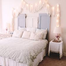 blue bed on white platform completed string lights for kids