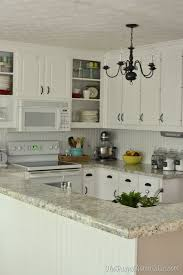 How To Refinish Kitchen Cabinets With Paint How To Re Paint Your Yucky White Cabinets