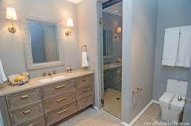 beachy bathroom designs easy coastal design idea beach with wooden frame wall lamp granite countertop mounted washbasin real wood vanity storage drawers easy way tie all guest bathroom ideas